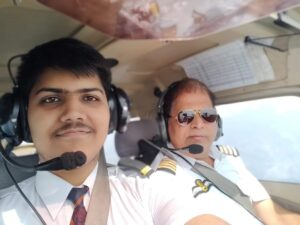 J P with son in cockpit